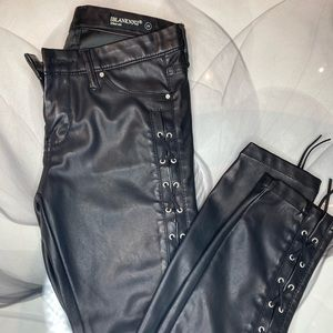 Lace up faux leather jeans